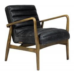 Czarny fotel ze skóry lata 70 nogi drewniane